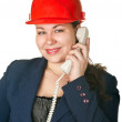 Stock Photo: Young woman architect helmet calling