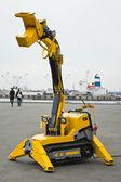 Yellow mechanical robotized mechanism — Stock Photo