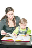Little child and mother reading — Stock Photo