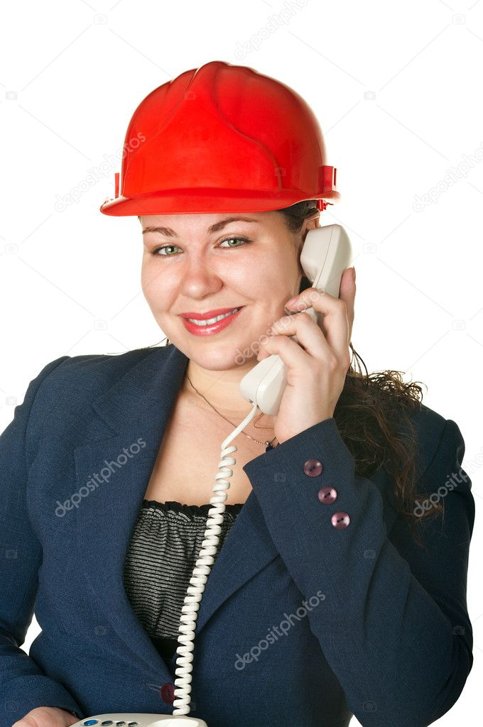 Young woman architect in red helmet calling by phone. Isolated on white background — Stock Photo #2877735