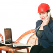 Woman in red helmet with phone - Stock Photo