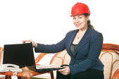 Woman in red helmet with laptop — Stock Photo