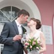 Bride and groom standing near registry office — Stock Photo #3166114