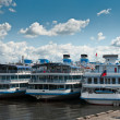 Stock Photo: Several white cruise liners are moored in river