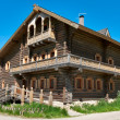 Stock Photo: Wooden big house from timbers and windows on it.