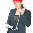 The girl in a red helmet calling by phone. - Stock Photo