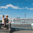 Loving couple teenagers near the cruise liners — Stock Photo #3166307