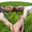 Young loving couple teenagers laying on grass — Stock Photo #3166310