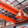 Large-tonnage industrial orange crane - Stock Photo