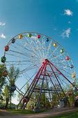 Merry go round wheel in park amusement — Stock Photo