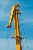 Yellow boom of harbour crane — Stock Photo