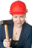 The young beautiful girl with a hammer — Stock Photo