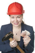 The young beautiful girl with a hammer and cash — Stock Photo