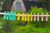 Colorful clothes-pegs on clothesline. — Stock Photo