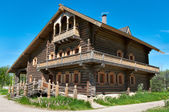 Wooden big house from timbers and windows on it. — Stock Photo