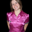 Young woman in pink on black background — Foto de Stock