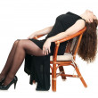 Beautiful white woman in dress on armchair. — Stock Photo