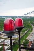 Two signal red lamp on height on big sedimentation drainages. Water recycling, settling, purification in the tank by biological organisms on the water station. — Stock Photo