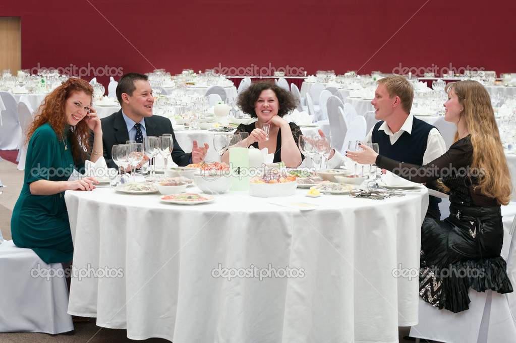 Five young at round white table in restaurant. Dinner party — Stock Photo #3304584