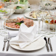 Table appointments for dinner in restaurant - Stock Photo