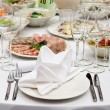 Stock Photo: Table appointments for dinner in restaurant