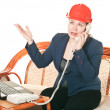 Woman in a red helmet with the laptop - Stock Photo