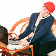 The girl in a red helmet with the laptop sits at a table and calling by pho — Stock Photo