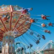 Stock Photo: Action photo of carousel on blue sky