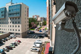 Optical camera on wall of building watching on parking — Stockfoto