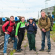 Group of travelers on railway station waiting a train. — Stock Photo