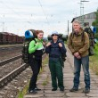 Group of travelers on railway station waiting a train. Mountaineering with — Stockfoto