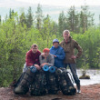 Group of travelers trekking in forest Mountaineering with knapsacks — Stock Photo #3587685