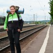 Backpacker a young woman waiting train on railway station — Stock Photo #3587699