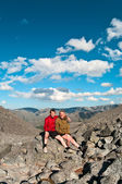 Father and son on peak of mountain. — Stock Photo
