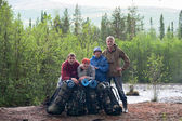 Group of travelers trekking in forest Mountaineering with knapsacks — Stock Photo
