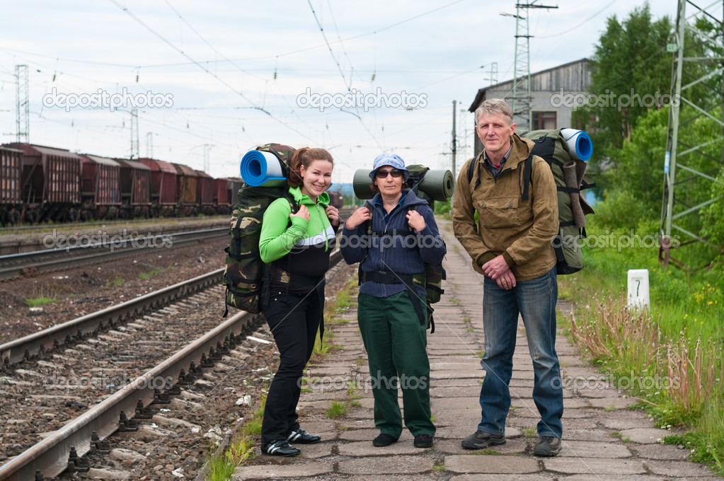 Group of travelers on railway station waiting a train. Mountaineering with knapsacks — Stock Photo #3587682