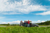 Family on a road trip. Group photo in front of car — Stock Photo