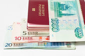 Pile of passports, euro cash banknotes and Russian banknote by thousand rub — Stock Photo