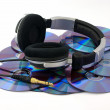 Stock Photo: Headphones on CD disks on white background