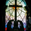 Catholic church stained-glass window - Stock Photo