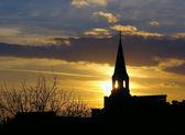 Lutheran church silhouette on sunset — Stock Photo