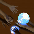 Hand and Luminous globe — Stock Photo #3164903