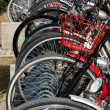 Lots of bicycles on a bicycle rack - Stock Photo