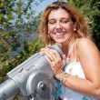 Smiling Blonde Girl Looking Trough Telescope with Surprised Face — Stock Photo #3603758