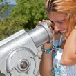 Smiling Blonde Girl Looking Trough Telescope with Surprised Face — Stock Photo