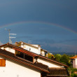 Rainbow over Roofs after the Storm — Stock Photo