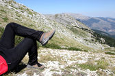 Person Relax on Top of a Mountain Against Great Panorama — Stock Photo