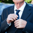 Senior Mwith Suit and Necktie at Celebration Event — Stock Photo #3826604