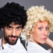 Young Man and Woman with Colorful Funny Wig — Stock Photo