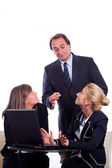Boss angry with Two Businesswoman Chatting instead of Working — Stock Photo
